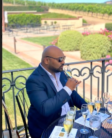 Anil drinking wine